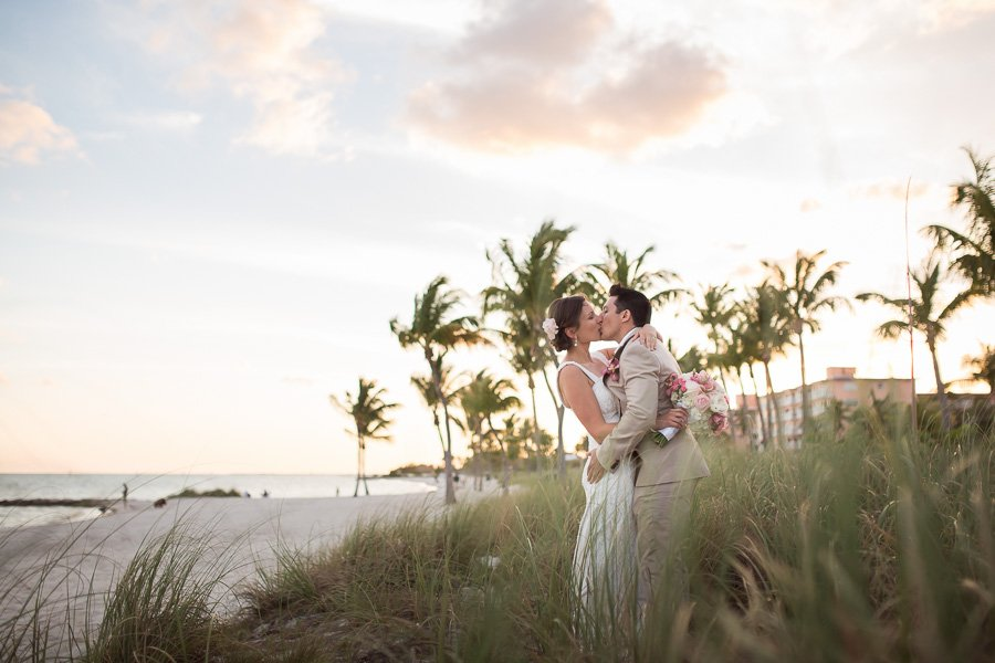 bride and groom in grass on smathers beach in key west floirida