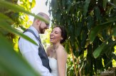bride and groom having fun in the bushes at hemingway home