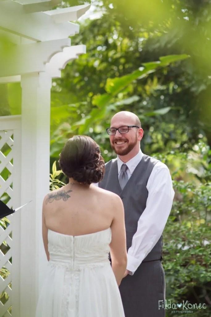 bride and groom at altar at hemingway home in key west florida