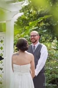 bride and groom at altar at hemingway home in key west florida