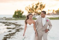bride and groom walking down the smathers beach in key west