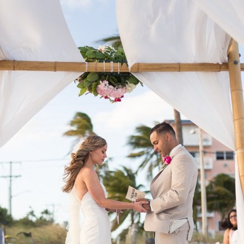 groom reading vows to his bride at their key west beach wedding