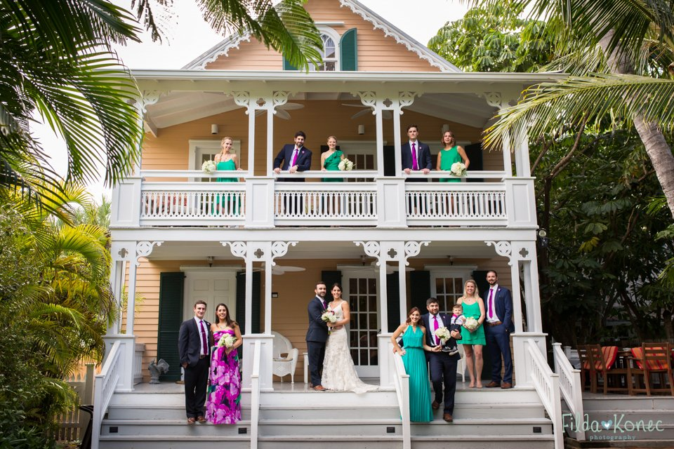 bridal party posing in front of house in key west, florida