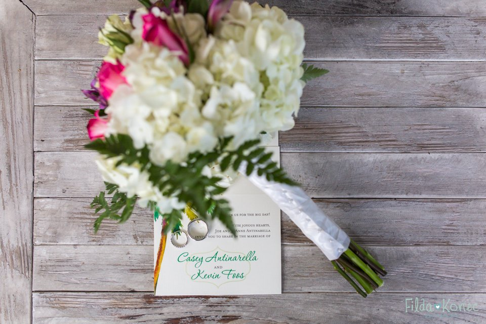 wedding bouquet with wedding invitation