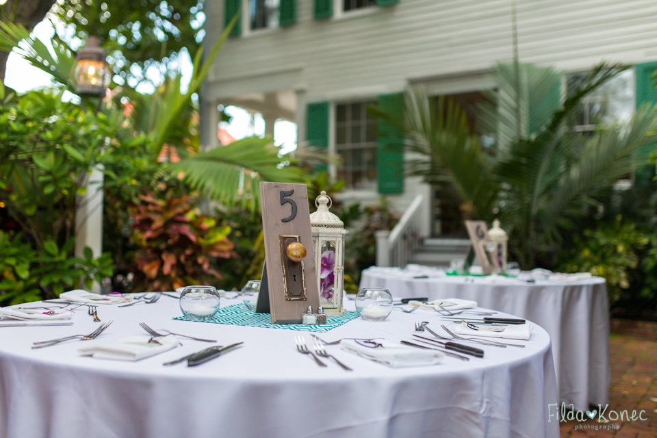 reception table set up at audubon house in key west, florida