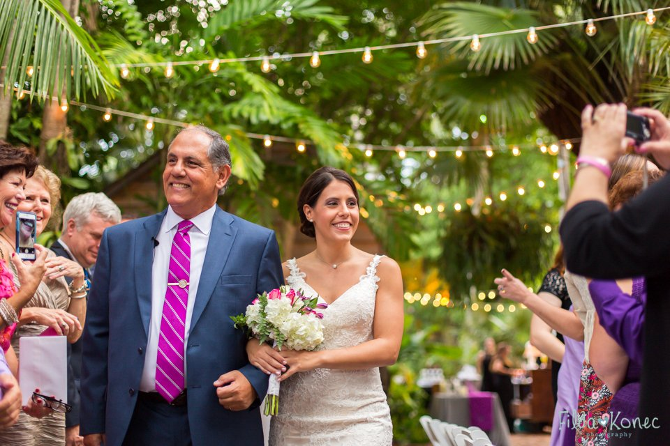 father walks his daughter down the isle at her wedding in audubon house in key west, florida