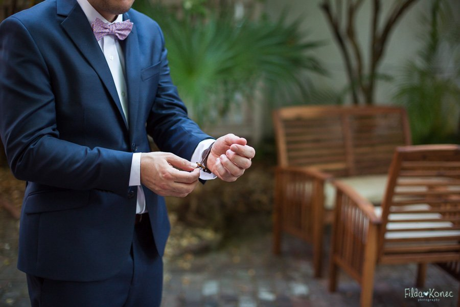 groom putting his watch on