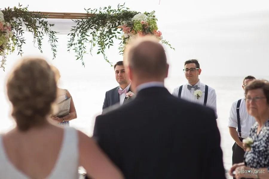 groom waiting on his bride for their beach wedding