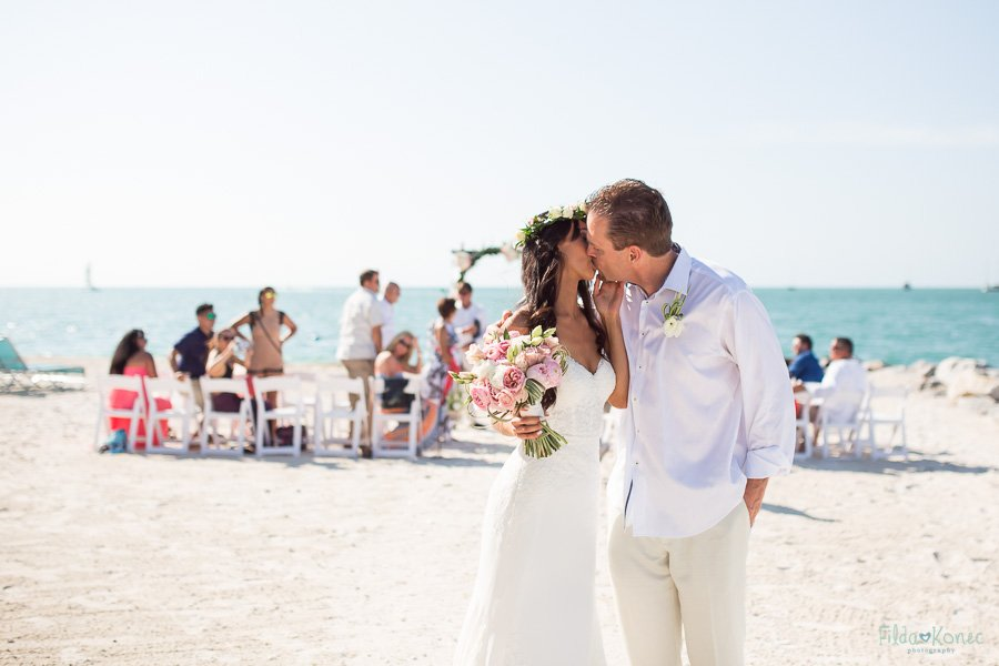 couple walks out the isle and kisses