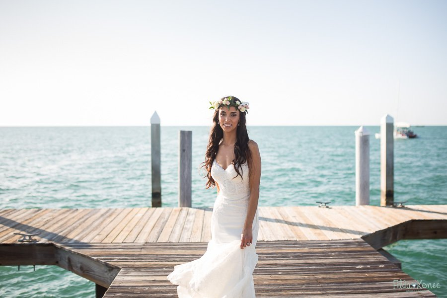 bride walks on sunset key pier in key west florida