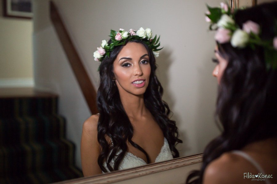 bride looking in the mirror before the ceremony