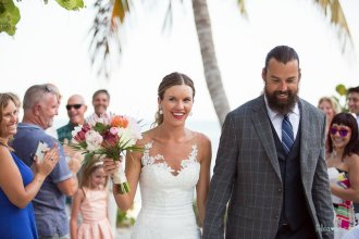 bride and groom walking out the aisle at their beach wedding in key west florida