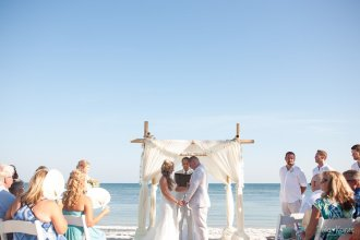 groom and bride at the altar during their ceremony
