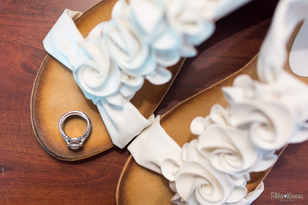 close up shot of wedding ring on bride's shoes