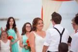 bride looking at her groom at their beach wedding