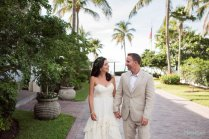 bride and groom walking on sunset key island