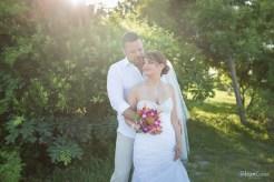 groom hugs his bride at their florida keys wedding
