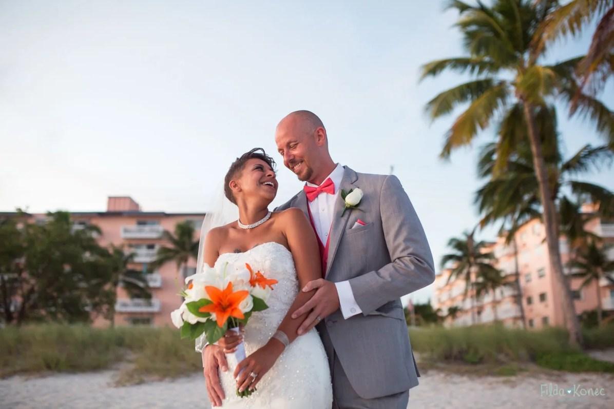 Groom hugs his bride on their wedding day on Key West beach