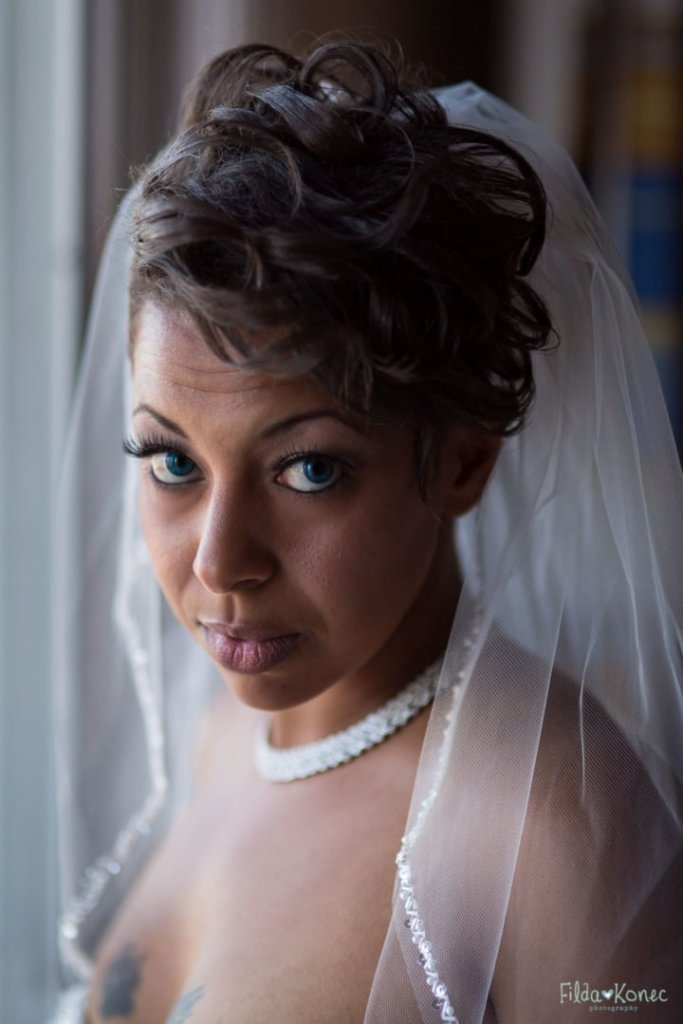 Bride is looking at the camera