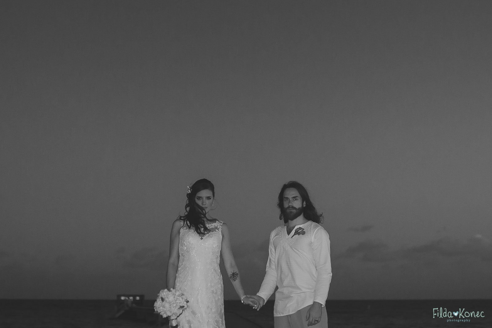 couple at higgs beach pier in key west florida