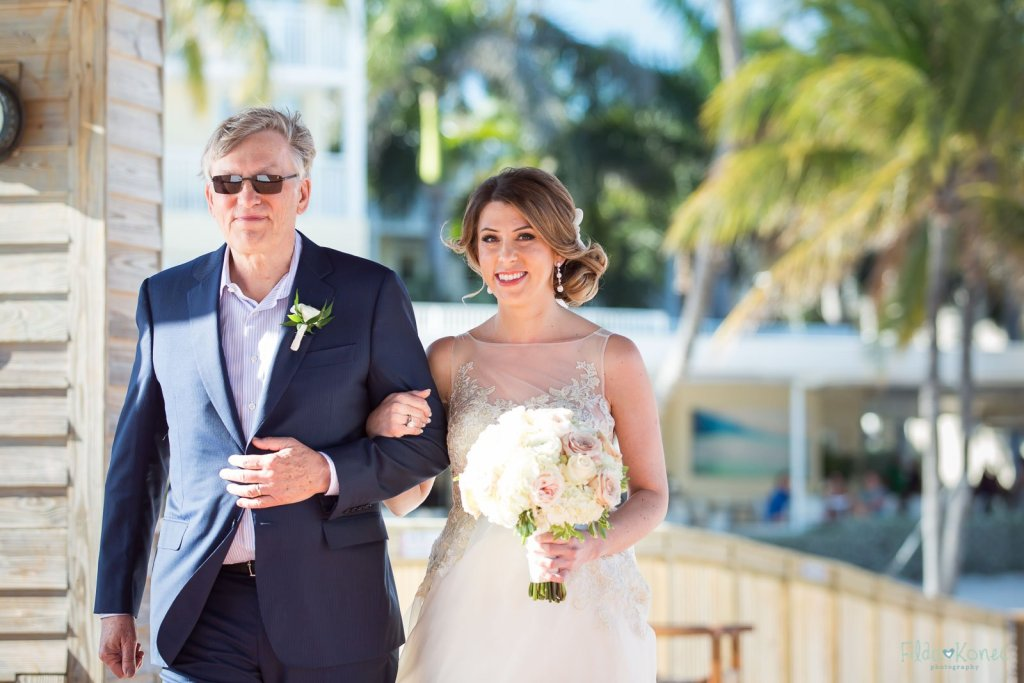 bride walks the isle with her father