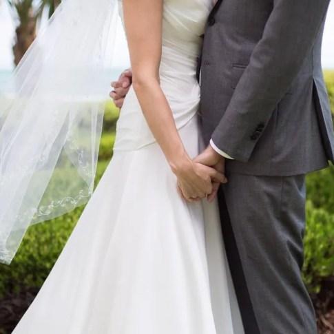 wedding photo of couple holding hands