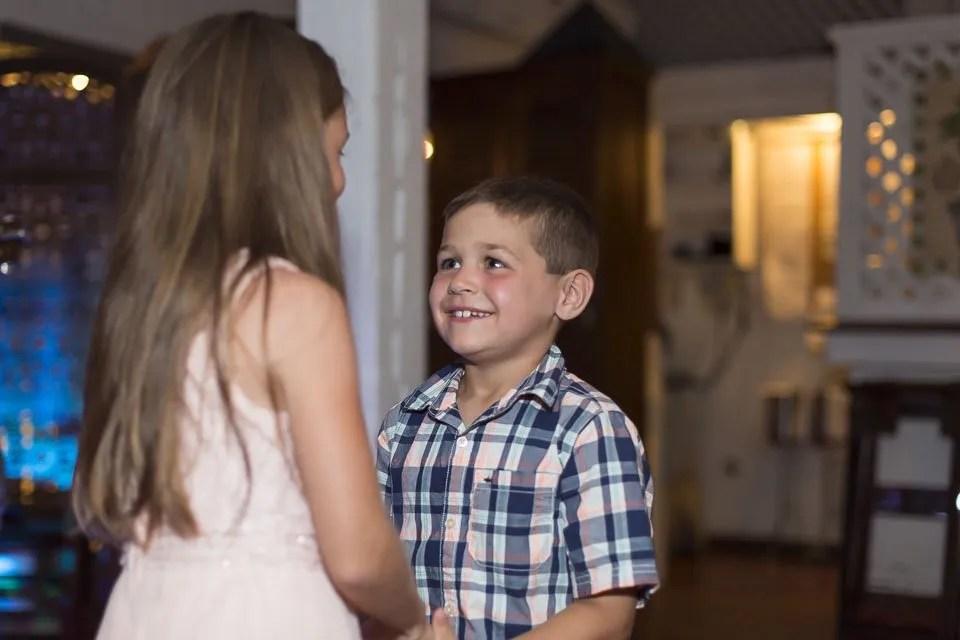 boy and girl dance at wedding reception