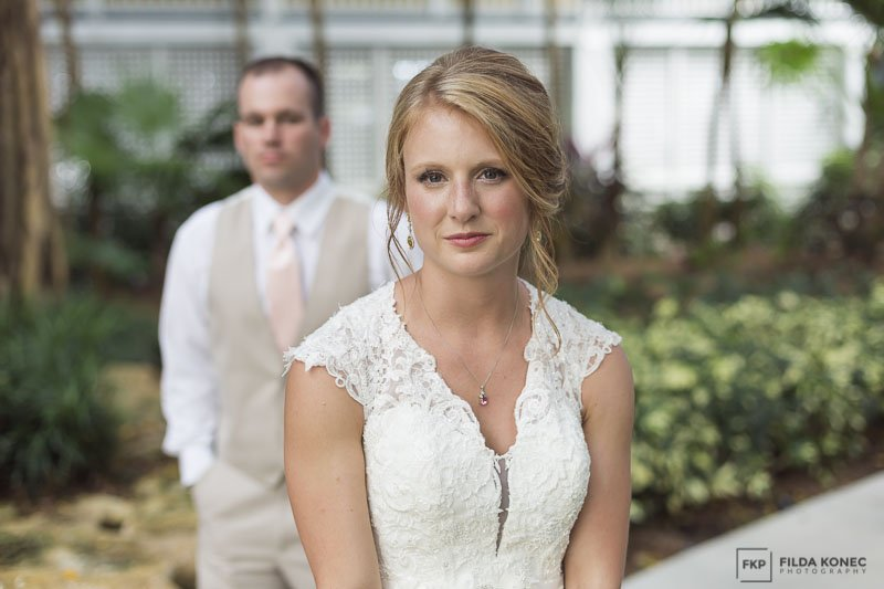 bride and groom pose for their key west beach wedding