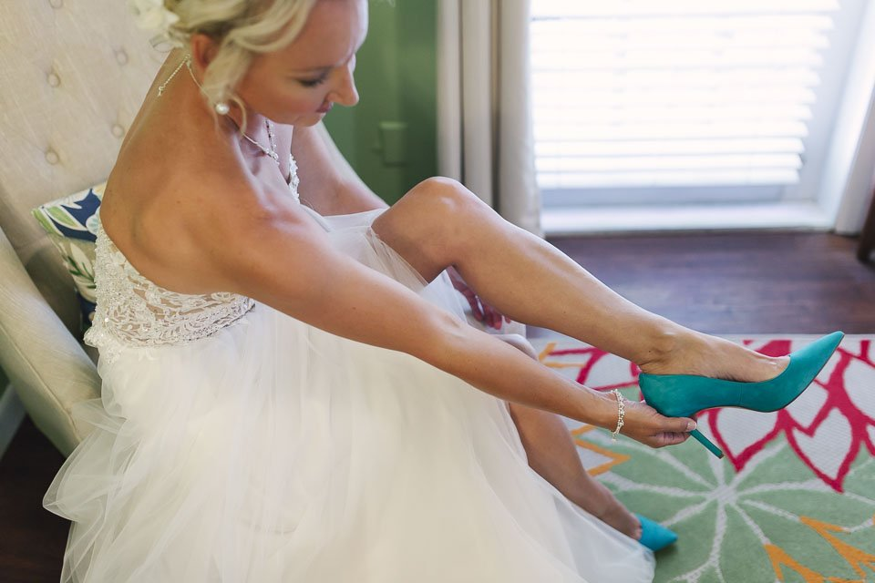 bride putting on bridal shoes for her key west wedding