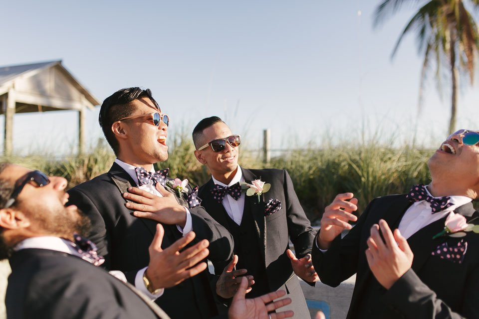 boys being funny at the beach ceremony