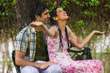 Couple-Enjoying-Rain