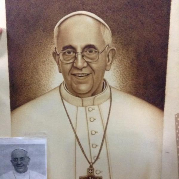 FIRST LOOK: Rape convict creates a wood-burned portrait of Pope Francis