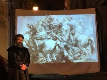 Michelangelo con lo sfondo della battaglia di Anghiari di Leonardo da Vinci