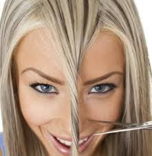 woman cutting hair with scissors 2