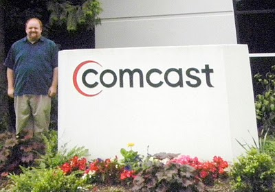 David vs. Goliath: Robb Topolski poses in front of Comcast Headquarters