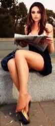 Mila Kunis Reading the paper