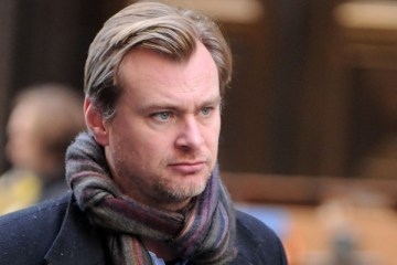 "Director Christopher Nolan works on the set of the latest Batman film, ""The Dark Knight Rises"" on Wall Street in New York on Sunday Nov. 6, 2011. (AP Photo/Darla Khazei)"