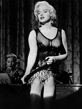Then again, she also wore this... so the film was definitely channeling a burlesque-feel for the costumes!