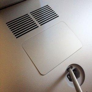 Pop open the access door in the back of your iMac.