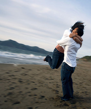 Hugging at the beach after individual counseling in Brea