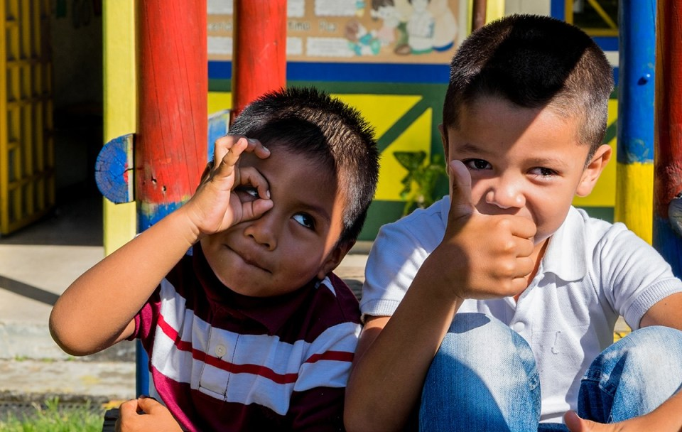 Two young students enjoy some recess time during their school day at Sede Barragán, a rural school of about 80 kids in Quindio. (Credit: Jared Wade)