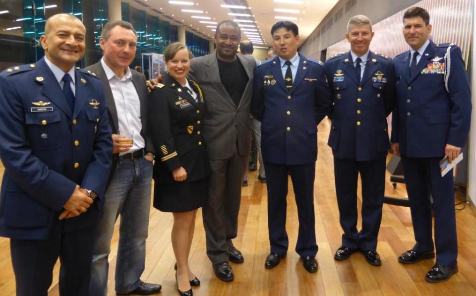 Left to right: Air Force Brigadier General Jose Mauricio Mancera Castaño (Colombia), Alexey Belov, Rosoboronexport (Russia), Army Major Emily Freeman (USA), Finance Colombia Publisher Loren Moss (USA), Lieutenant Colonel Eldar Sadykov (Russia), Air Force Brigadier General Juan Marcos Perdomo Robledo (Colombia), and Air Force Colonel Pete Schaub (USA) at the F-Air Colombia 2015 launch reception.