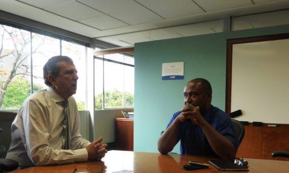 EAFIT's Rector, Dr. Juan Luis Mejia Arango (left) explains the university's vision to Finance Colombia's Loren Moss