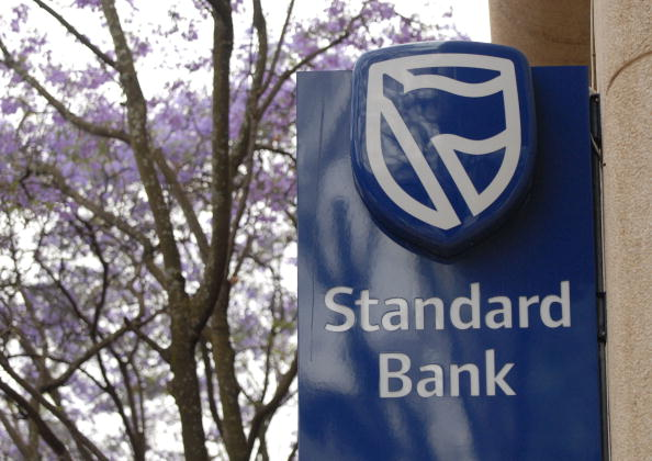 SOUTH AFRICA - OCTOBER 25: The Standard Bank logo is displayed at a branch in Rosebank, Johannesburg, South Africa, on Thursday, Oct. 25, 2007. Industrial & Commercial Bank of China Ltd. will pay 36.7 billion rand ($5.6 billion) for a 20 percent stake in Standard Bank Group Ltd., Africa's largest bank, in the biggest overseas acquisition by a Chinese company. (Photo by Naashon Zalk/Bloomberg via Getty Images)