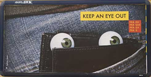 image of two eyes staring out of a pocket