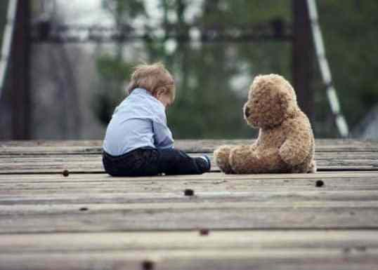 a child and a bear with generational wealth