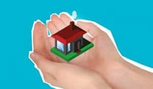 photo of house in someone's hand representing property insurance