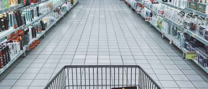 grocery cart with items showing why aldi is cheaper than other stores