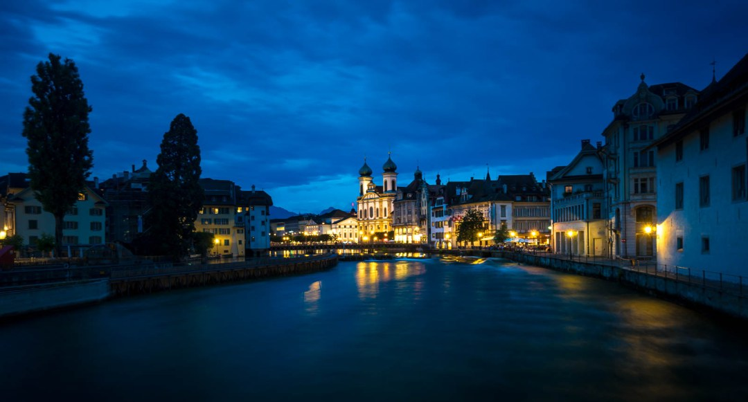 Night time along Reuss River in Lucerne Switzerland.