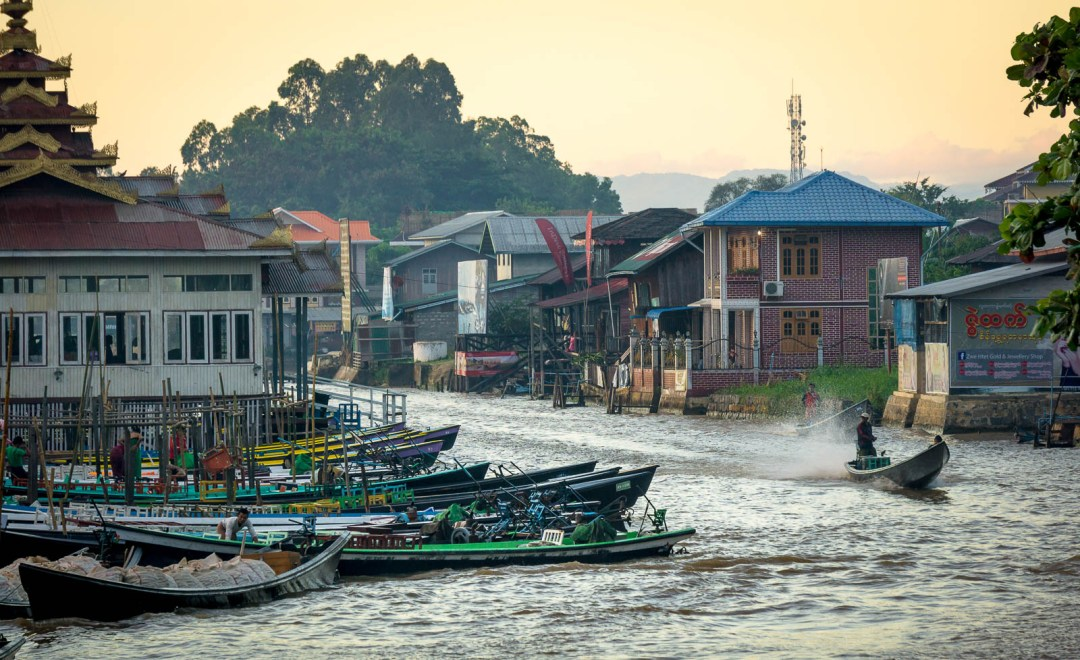 Boats and houses on banks of Nuang Shwe